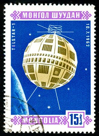 Ukraine - circa 2018: A postage stamp printed in Mongolia show Sputnik Telstar 1. Series: Space satellites. Circa 1966. Éditoriale