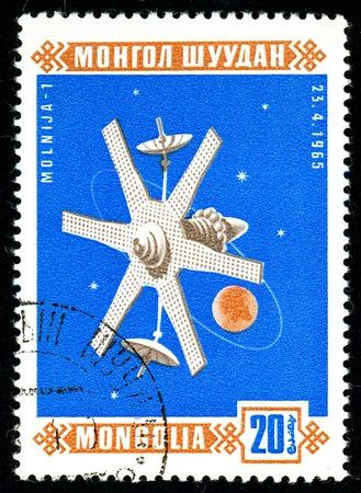 Ukraine - circa 2018: A postage stamp printed in Mongolia show Sputnik Molnija 1. Series: Space satellites. Circa 1966. Éditoriale