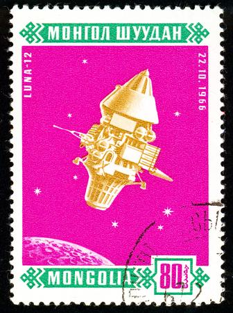 Ukraine - circa 2018: A postage stamp printed in Mongolia show Sputnik Luna 12. Series: Space satellites. Circa 1966. Éditoriale