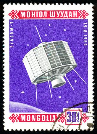 Ukraine - circa 2018: A postage stamp printed in Mongolia show Sputnik Syncom 3. Series: Space satellites. Circa 1966.