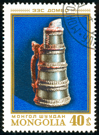 Ukraine - circa 2018: A postage stamp printed in Mongolia show Wine jar. Circa 1974.