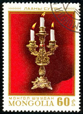 Ukraine - circa 2018: A postage stamp printed in Mongolia show Three arm candlestick. Circa 1974.