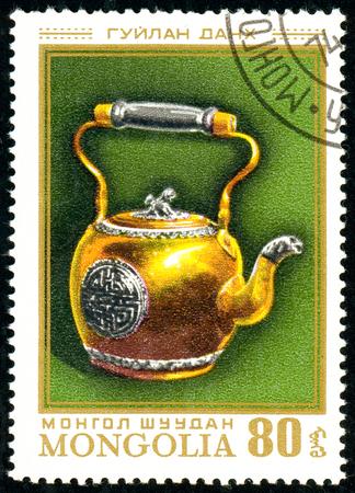 Ukraine - circa 2018: A postage stamp printed in Mongolia show Teapot. Circa 1974.