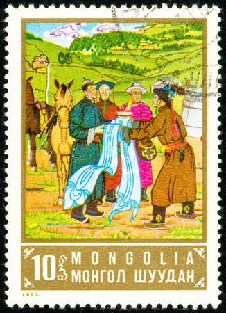 Ukraine - circa 2018: A postage stamp printed in Mongolia show a picture of the artist Suchbaatar. Series: Paintings. Circa 1973.