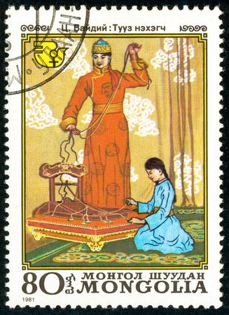 Ukraine - circa 2018: A postage stamp printed in Mongolia show scene National Festivals. Weavers. Series: International Decade for Women. Circa 1981.