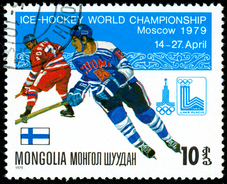 Ukraine - circa 2018: A postage stamp printed in Mongolia show hockey with the puck. A player in the uniform of Finland. Flag Finland. Series: Moscow ice hockey world championships. Circa 1979.