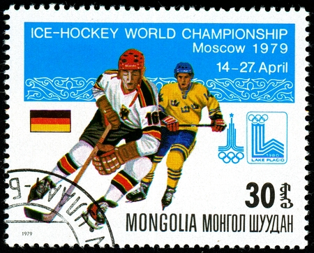 Ukraine - circa 2018: A postage stamp printed in Mongolia show hockey. A players in the uniform of Germany and Sweden. Flag Germany. Series: Moscow ice hockey world championships. Circa 1979.