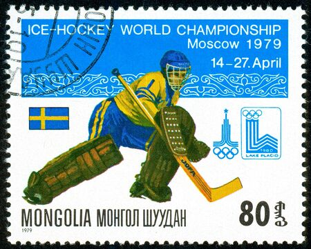 Ukraine - circa 2018: A postage stamp printed in Mongolia show hockey. A player in the uniform of Sweden. goalkeeper. Flag Sweden. Series: Moscow ice hockey world championships. Circa 1979.