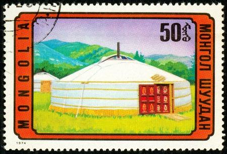 Ukraine - circa 2018: A postage stamp printed in Mongolia show Mongolian jurte. Series: Mongolian Architecture. Circa 1974.