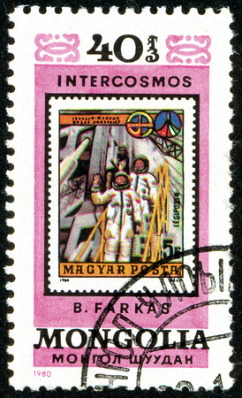 Ukraine - circa 2018: A postage stamp printed in Mongolia show cosmonauts Valeri Kubasov and Bertalan Farkas. Series: Intercosmos, Space Programme. Circa 1980.