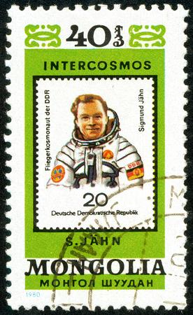 Ukraine - circa 2018: A postage stamp printed in Mongolia show cosmonaut Jahn, DDR. Series: Intercosmos, Space Programme. Circa 1980.
