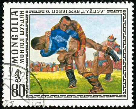 Ukraine - circa 2018: A postage stamp printed in Mongolia show Wrestlers. Mongolian National Sport. Series: Paintings by O. Cevegshava. Circa 1976.
