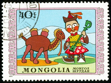 Ukraine - circa 2018: A postage stamp printed in Mongolia show the child plays a stringed musical instrument and a camel. Series: International Childrens Day. Circa 1975.