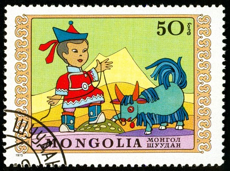 Ukraine - circa 2018: A postage stamp printed in Mongolia show Boy and obedient little yak. Series: International Childrens Day. Circa 1975.