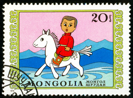 Ukraine - circa 2018: A postage stamp printed in Mongolia show Boy on horseback. Series: International Childrens Day. Circa 197
