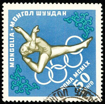 Ukraine - circa 2018: A postage stamp printed in Mongolia show Floor gymnastics. Series: Summer Olympics 1960, Rome. Circa 1960.