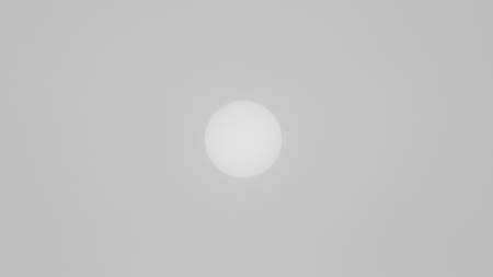 The view of the sun through a dense fog on a winter day. Frost. Minimalism. Soft focus