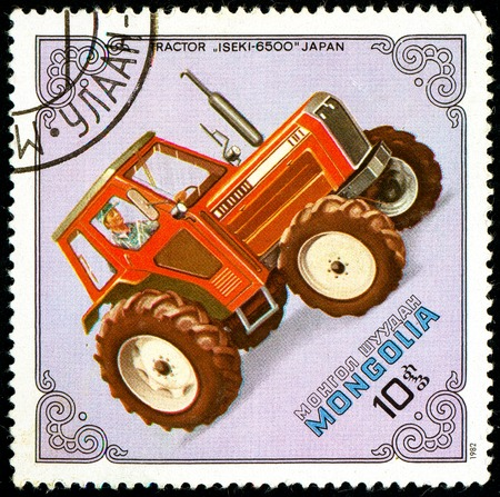 Ukraine - circa 2018: A postage stamp printed in Mongolia show Iseki-6500 Tractor, Japan. Series: Tractors. Circa 1982