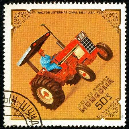 Ukraine - circa 2018: A postage stamp printed in Mongolia show Tractor Intl.-884, USA. Series: Tractors. Circa 1982