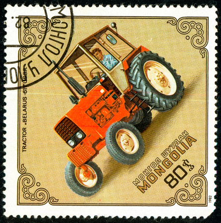 Ukraine - circa 2018: A postage stamp printed in Mongolia show Tractor Belarus-611, USSR. Series: Tractors. Circa 1982