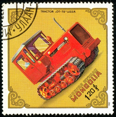 Ukraine - circa 2018: A postage stamp printed in Mongolia show Tractor Dt-75, USSR. Series: Tractors. Circa 1982