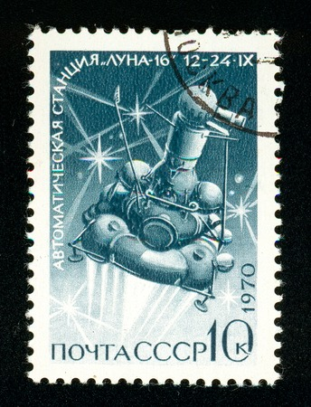 Ukraine - circa 2018: A postage stamp printed in Soviet Union, USSR show Station Luna-16 in flight. Series: Soviet Automatic Station Luna-16. Circa 1970. Sajtókép