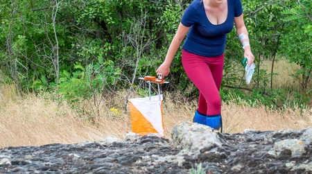 Orienteering. Check point Prism and composter for orienteering. The athlete marks the passage of the control point. Orienteering race