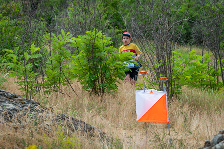 Yuzhnoukrainsk, Ukraine - May 26, 2018: Orienteering race. Traditional annual orienteering game Partisan Spark Cup 2018. The athlete is come near the checkpoint.