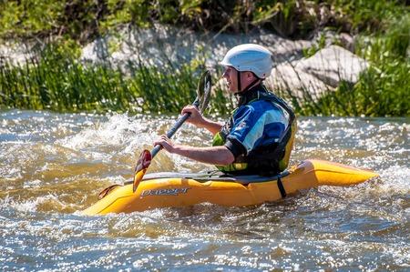 Myhiya, Ukraine - May 1, 2018: Rafting, kayaking. An unidentified man are sailing on his short Dagger whitewater kayak. Extreme sport. Ecological water tourism. Emotions. Water splash close-up