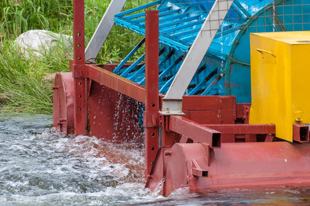 The mini hydroelectric power plant - ecologically clean source of renewable energy. Green energy. The mechanism of close-up