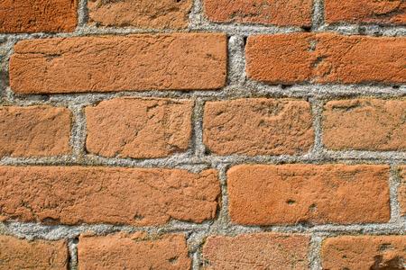 Brick wall close-up. Brick laying on cement mortar