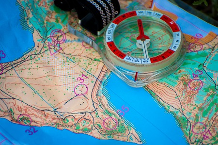 Orienteering. Compass and topographic map. Navigation equipment for orienteering. The concept Imagens