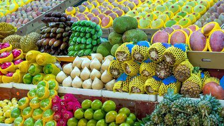 Fresh tropical fruits are on the market window. Healthy, organic food. Banana, pineapple, ananas, durian, Dragon fruit, coconut, mango, mangosteen, rambutan Stock Photo