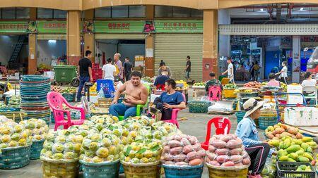 Sanya, Hainan, China - May 18, 2019: Typical Asian fruit market. Fresh tropical fruits are on the market window. Healthy, organic food Editorial