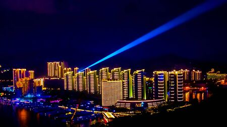 View of the night city of Sanya. Hainan Island, China. Neon lights of the night metropolis Stock Photo - 128429057