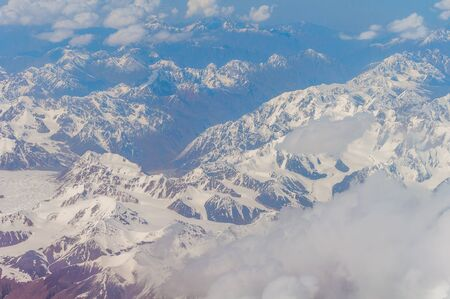 View from the illuminator of the plane to Zailiyskiy Alatau, a mountain range in the northwest of Tien Shan Stock Photo - 128429178