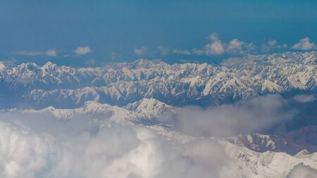 View from the illuminator of the plane to Zailiyskiy Alatau, a mountain range in the northwest of Tien Shan