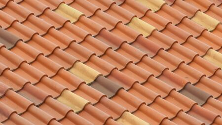 The roof is covered with red tiles. Background