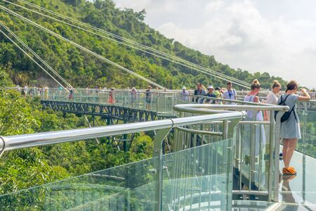 Blur. China. The mountains are covered with impassable tropical forests, jungles. Hainan island, Forest Park Yanoda. Observation deck in the form of a glass bridge at an altitude of more than 200 m. 에디토리얼