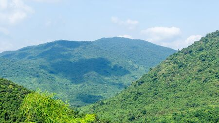 China. The mountains are covered with impassable tropical forests, jungles. Cultural Tourism Zone Hainan island, Yalong Bay Tropical Paradise Forest Park Yanoda. Stock Photo