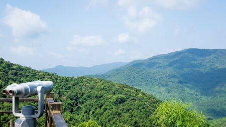 The mountains are covered with impassable tropical forests, jungles. Cultural Tourism Zone Hainan island, Yalong Bay Tropical Paradise Forest Park Yanoda. View from the observation deck.