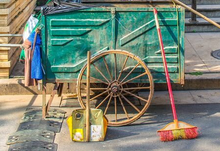 Tools for garbage collection on the street - broom, wagon, scoop