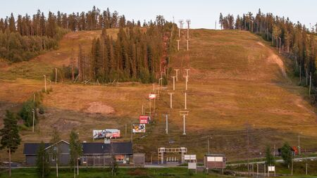 Finland - August 19, 2018. Ukkohalla Ski Resort. The most environmentally friendly air. A lake in the middle of a forest. Cozy picturesque cottages. View of the ski slopes in summer