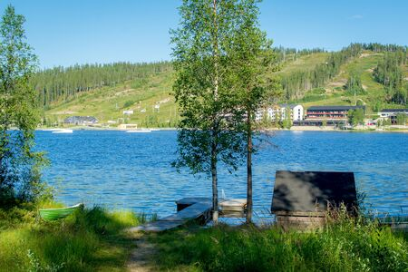Finland - July 28, 2018. Ukkohalla Ski Resort is located in Central Finland, the Kainuu region. The most environmentally friendly air. A lake in the middle of a forest. Cozy picturesque cottages