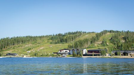 Finland - July 29, 2018. Ukkohalla Ski Resort is located in Central Finland, the Kainuu region. The most environmentally friendly air. A lake in the middle of a forest. Cozy picturesque cottages