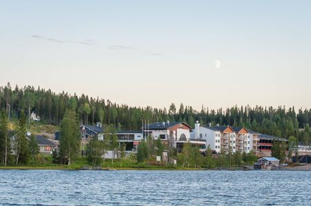 Finland - August 19, 2018. Ukkohalla Ski Resort is located in Central Finland, the Kainuu region. The most environmentally friendly air. A lake in the middle of a forest. Cozy picturesque cottages Éditoriale
