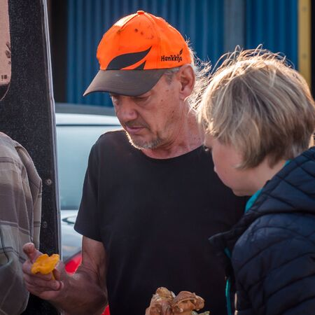 Kontiomaki, Finland - August 29, 2018. Inexperienced mushroom pickers brought mushrooms to the plant for the first time. The mushroom inspector explains how to distinguish good from bad mushrooms