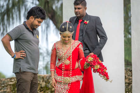 Galle, Sri Lanka - May 28, 2016: Bride and groom. Behind the curtains of a wedding photo shoot of Sri Lankan couples. Backstage photo session love story. Sajtókép