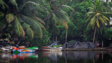 Balapitiya, Madu Ganga river, Sri Lanka - May 29, 2016: Boats for a river safari.