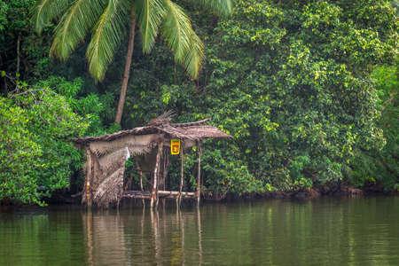 Balapitiya, Madu Ganga river, Sri Lanka - May 29, 2016: Traditional river shop built on the river on stilts. Éditoriale